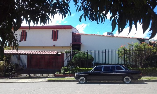 RED-AND-WHITE-MANSION.-COSTA-RICA-MERCEDES-LIMO-PICK-UP-SERVICE.jpg